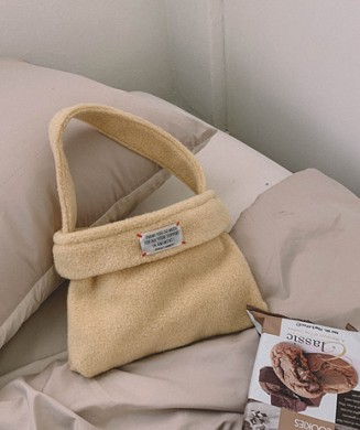 Stitch brushed mini bag